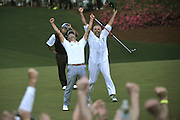 Australian Adam Scott celebrates alongside caddy Steve Williams after defeating Angel Cabrera during a sudden-death playoff round to win the Masters at Augusta National on April 14, 2013 in Augusta, Georgia. Adam Scott defeated Angel Cabrera in a playoff to become the first Australian to win a Green Jacket.