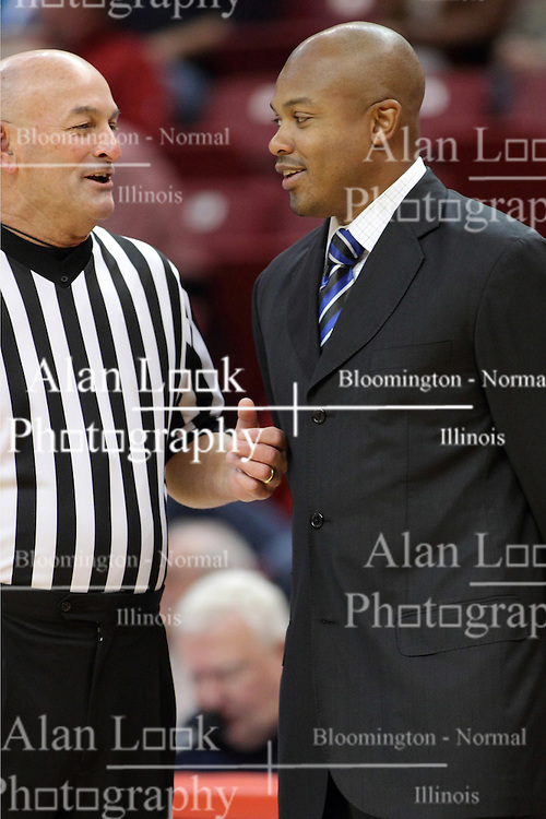 29 November 2014:  Referee Rick Randall speaks with Torrey Ward during an NCAA men's basketball game between the Youngstown State Penguins and the Illinois State Redbirds  in Redbird Arena, Normal IL.