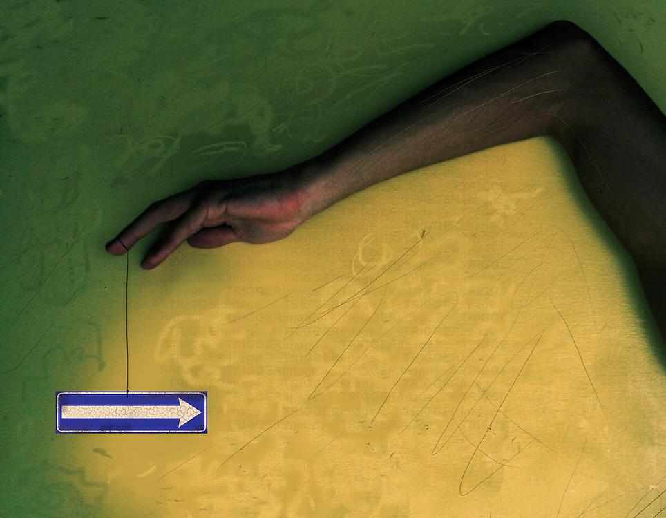 An arm and hand near an arrow