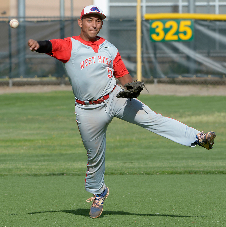 gbs042517p/SPORTS -- West Mesa's third baseman Diego Armijo throws to first during the game at Valley on Tuesday, April 25, 2017.  (Greg Sorber/Albuquerque Journal)