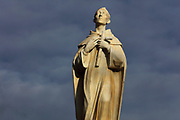 Statue of San Juan de la Cruz or St John of the Cross, by Francisco Palma Burgos, 1918-85, inaugurated in 1959, on the Plaza Primero de Mayo in Ubeda, Jaen, Andalusia, Spain. San Juan de la Cruz, 1542-91, was a Spanish mystic, Roman Catholic saint, Carmelite friar and priest and one of the Doctors of the Church. In 2009 the statue was restored by Manuel Martos Leiva. Picture by Manuel Cohen