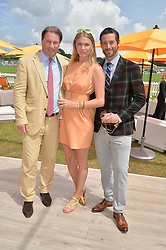 Left to right, JO THORNTON, JODIE KIDD and DAVID BLAKELEY at the Veuve Clicquot Gold Cup Final at Cowdray Park Polo Club, Midhurst, West Sussex on 20th July 2014.