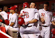 Thursday, April 18, 2013 REDS SPORTS : Cincinnati Reds third baseman Todd Frazier (21) celebrates his sixth inning two-run home run with guest bat boy Teddy Kremer at Great American Ball Park. The Enquirer/Jeff Swinger