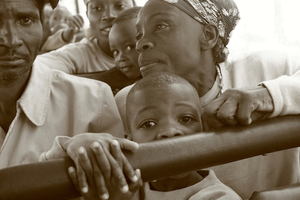 Burundian refugees who were in a refugee camp in Tanzania seen here in a bus in the Tanzanian border waiting to be convoyed to Burundi to go back to their hills and start a new life..@ Martine Perret. 14 July 2005