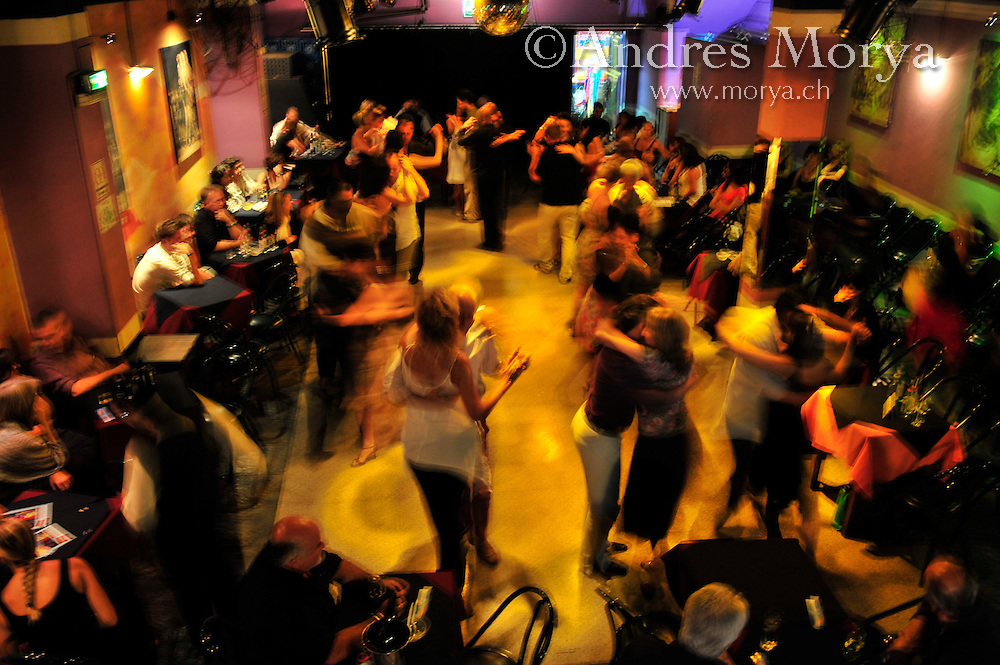 Tango Dancers in the Milonga Porteño y Bailarin, Buenos Aires, Argentina Image by Andres Morya