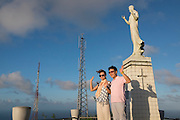 Chinese couple pose atop Saipan's highest point overlooking the whole island. A fierce battle was fought there in WWII.