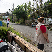 OCTOBER 18 - LARES, PUERTO RICO - <br /> Mercy Corps staffers Jill Morehead, right, and Alexa Swift, inspect a house on a hill in Lares as part of their field research on Puerto Rico's supply needs following the destructive path of hurricane Maria.<br /> (Photo by Angel Valentin for NPR)