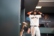 San Francisco Giants shortstop Brandon Crawford (35) puts on his helmet before going up for bat against the New York Mets at AT&T Park in San Francisco, Calif., on August 21, 2016. (Stan Olszewski/Special to S.F. Examiner)