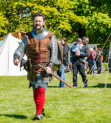 Medieval Day. Dirleton Castle, East Lothian, Scotland, United Kingdom, 11 May 2019. Pictured:  Historic Environment Scotland family fun day at the Living Medieval Village by Saltire History Society in the castle gardens. Andrew Spratt, custodian at the castle dressed as Robert the Bruce, King of Scots.<br /> <br /> Sally Anderson | EdinburghElitemedia.co.uk