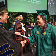 FAIRFAX, VA -DEC21: Emerita Ayala, 23, receives her diploma during commencement at George Mason University, December 21, 2016, in Fairfax, Virginia, where she earned her bachelor's degree. It's been a long odyssey through college, Emerita started as a teenage mom at 18, with her 3-year-old son at community college. She got help through a nonprofit called Generation Hope that provides scholarships and mentoring to teenage moms. (Photo by Evelyn Hockstein/For The Washington Post)