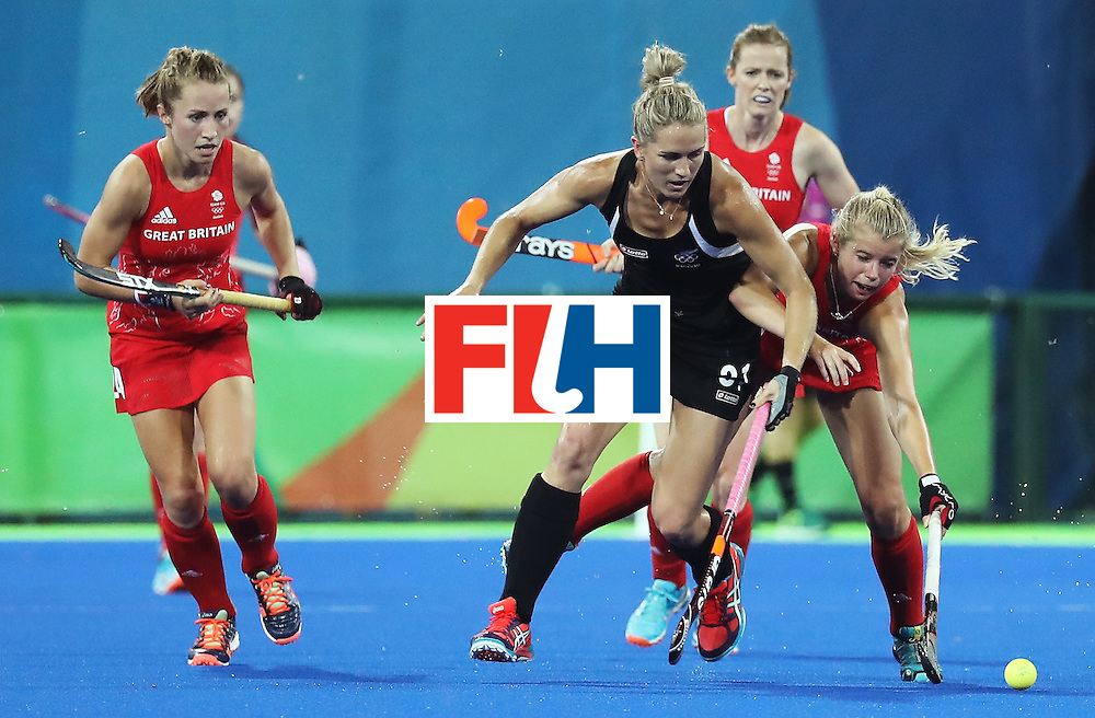 RIO DE JANEIRO, BRAZIL - AUGUST 17:  Liz Stacey Michelsen #31 of New Zealand and Susannah Townsend #9 of Great Britain in action during the Women's Semifinal match between New Zealand andGreat Britain on Day 12 of the Rio 2016 Olympic Games at the Olympic Hockey Centre on August 17, 2016 in Rio de Janeiro, Brazil.  (Photo by Rob Carr/Getty Images)