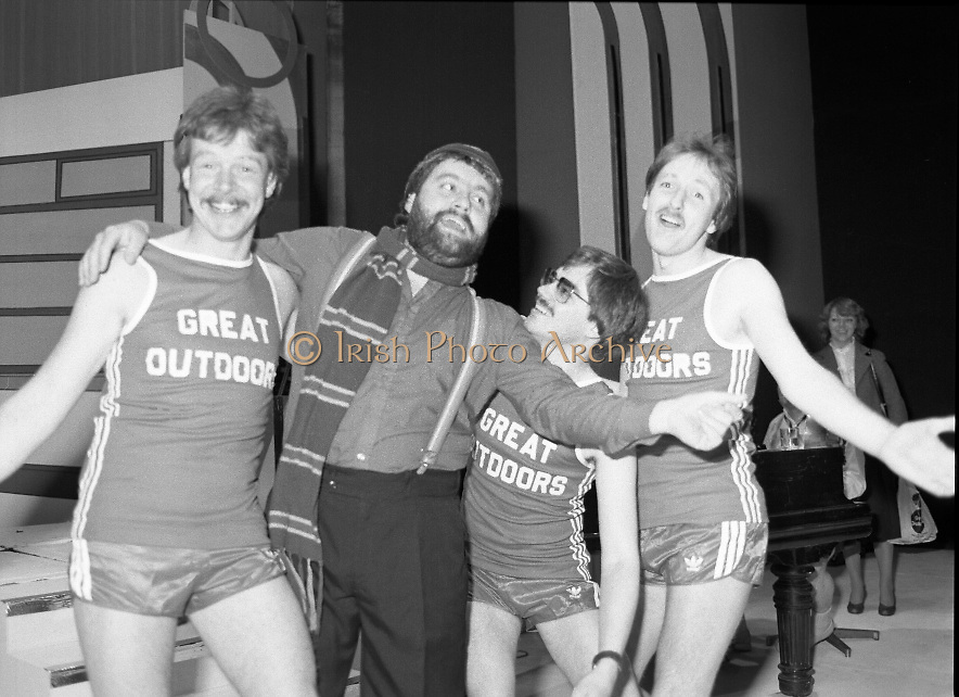 """Brendan Grace with Joggers at The Gaiety Theatre,Dublin 2 Ireland.1982.24.05.1982.05.24.1982.24th May 1982 .Brendan Grace in """"Bottler"""" mode takes time out from rehearsals at the Gaiety Theatre. As one of the celebrities taking part in this years CRC """"Jogathon"""", he is meeting with some runners from the """"Great Outdoors""""who will also take part..From left: Derek O'Connor, """"Bottler"""",Tom Hogarty and Jimmy Hayden"""
