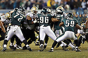The Philadelphia Eagles defense plugs the holes during the NFL NFC Wild Card football game against the New Orleans Saints on Saturday, Jan. 4, 2014 in Philadelphia. The Saints won the game 26-24. ©Paul Anthony Spinelli