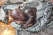 Africa, Ethiopia, Omo Valley sleeping Konso tribe baby