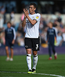Derby County's Craig Forsyth applauds the away fans at full time