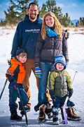 The Orlet family gathers for a quick portrait during a break from a ice hockey game on the lake.