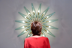 "© Licensed to London News Pictures. 28/06/2017. London, UK.  A woman views a ""Dahlia"" chandelier by Max Ingrand.  Preview day at Masterpiece London, a leading art fair held in Chelsea, bringing together 150 international exhibitors presenting works from antiquity to the present day.  The event runs 29 June to 5 July 2017.   Photo credit : Stephen Chung/LNP"
