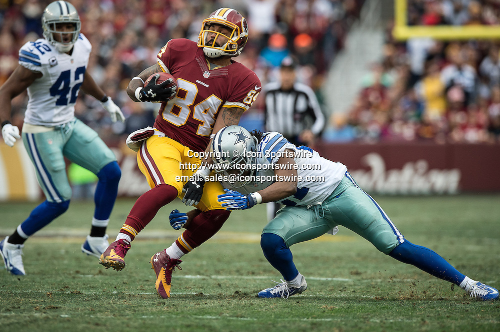Dec. 28, 2014 - Landover, Maryland, U.S - Washington Redskins tight end NILES PAUL (84) with a first down reception before Dallas Cowboys free safety J.J. WILCOX (27) can get him down .The Dallas Cowboys beat the Washington Redskins 44-17 at FedEx Field in Landover, Maryland