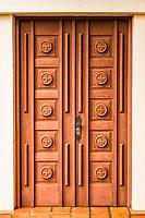 Porta lateral da Igreja Matriz São João Bosco. Modelo, Santa Catarina, Brasil. / <br /> Side door of São João Bosco Mother Church. Modelo, Santa Catarina, Brazil.
