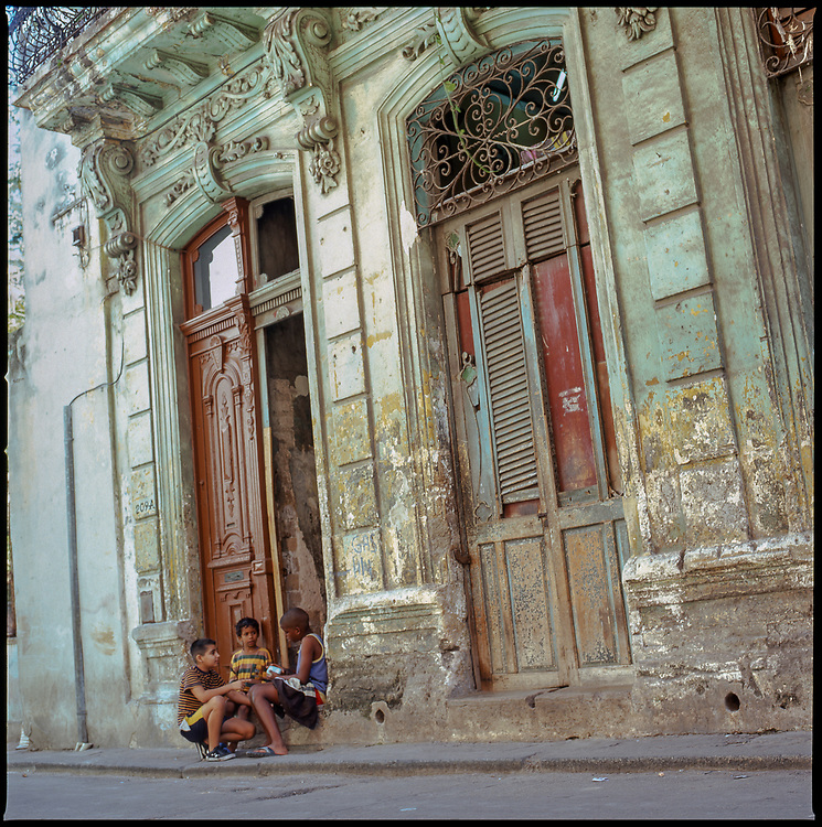 Three Kids Sitting in Decayed Doorway, Havana, Cuba