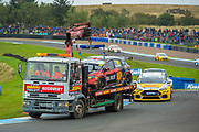 The car of Nic HAMILTON (GBR) of ROKiT Racing with Motorbase is removed from the circuit on the back of a recovery truck after he crashes during Round 22 of the 2019 British Touring Car Championship at Knockhill Racing Circuit, Dunfermline, Scotland on 15 September 2019.
