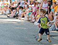 Alex Mackey, 2, of Cedar Rapids jumps to the music at the Freedom Festival Parade downtown Cedar Rapids, Iowa on Saturday, June 26, 2010.