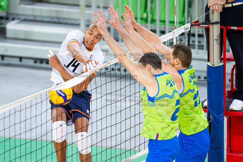 30-12-2019 SLO: Slovenia - Netherlands, Ljubljana<br /> Nimir Abdel-Aziz of the Netherlands and Tine Urnaut, Alen Pajenk of Slovenia during friendly volleyball match between National Men teams of Slovenia and Netherlands