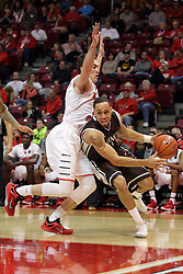 27 November 2015: Von Washington III undercuts defender Justin McCloud(15). Illinois State Redbirds host the Quincy Hawks at Redbird Arena in Normal Illinois (Photo by Alan Look)