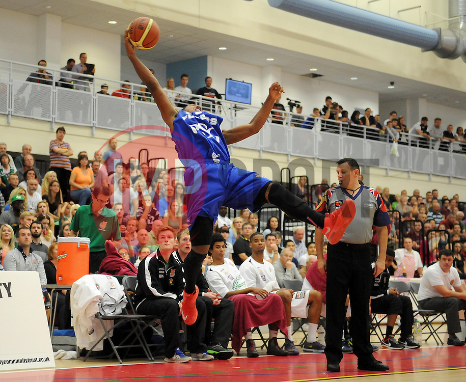 Bristol Academy Flyers' Dwayne Lautier-Ogunleye keeps the ball in play  - Photo mandatory by-line: Joe Meredith/JMP - Mobile: 07966 386802 - 27/09/2014 - SPORT - Basketball - Bristol - SGS Wise Campus - Bristol Academy Flyers v Plymouth Uni Raiders - British Basketball League