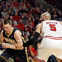 16 April 2011: Indiana Pacers power forward Tyler Hansbrough (50) is fouled by Chicago Bulls power forward Carlos Boozer (5) during the Chicago Bulls 104-99 victory over the Indiana Pacers, during the game 1 of the Eastern Conference first round at the United Center, Chicago, Illinois, USA.