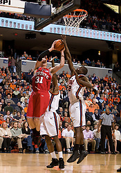 North Carolina State forward Dennis Horner (31) shoots over Virginia guard/forward Mamadi Diane (24).  The Virginia Cavaliers men's basketball team defeated the North Carolina State Wolfpack 78-60 at the John Paul Jones Arena in Charlottesville, VA on February 24, 2008.