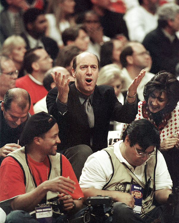 Chicago movie critic  Gene Siskel  yells at the officials during game 2 of the NBA Finals in Chicago. June 1997. Photo by August Miller