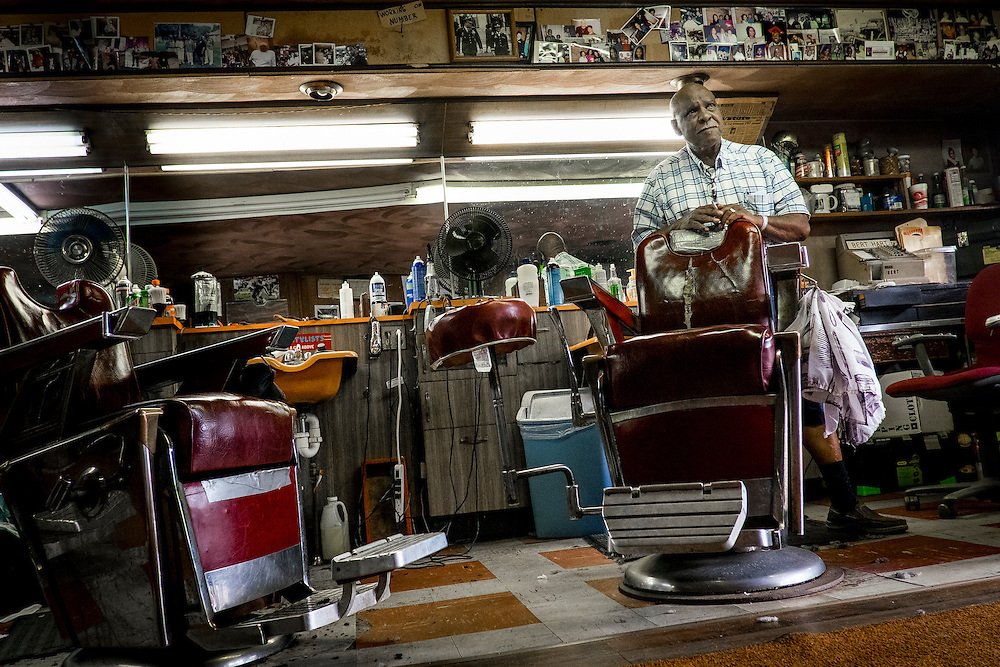 80-year-old Bert Hart  has been cutting hair in his Aliquippa barber shop for the past 60 years. Hart moved to Aliquippa in the boom times of the 1960&rsquo;s and opened Bert&rsquo;s Barber Shop in 1966.<br /> <br /> At that time the town was home to over 26,000 people but most of the homes and businesses along his street are gone as well as most of the people.<br /> <br /> At one time Hart owned three adjacent buildings, housing a bar, apartment building and the barber shop, in the Plan 11 neighborhood.<br /> <br /> The three-chair shop is a place where people hang out here and talk about everything from politics to religion and sports as well as the good old days when Aliquippa was thriving.