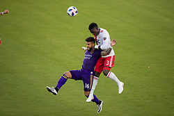 August 4, 2018 - Orlando, FL, U.S. - ORLANDO, FL - AUGUST 04: Orlando City forward Dom Dwyer (14) and New England Revolution defender Jalil Anibaba (3) go for the ball during the soccer match between the Orlando City Lions and the New England Revolution on August 4, 2018 at Orlando City Stadium in Orlando FL. (Photo by Joe Petro/Icon Sportswire) (Credit Image: © Joe Petro/Icon SMI via ZUMA Press)