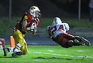 Marion's Tyler Gunderson (5) pulls in a touchdown reception as Western Dubuque's Dylan James (24) dives for the ball during their first round playoff game at Thomas Park Field in Marion on Wednesday, October 24, 2012.
