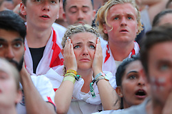 © Licensed to London News Pictures. 11/07/2018. London, UK. England fans in Flat Iron Square, London, react as they watch England play Croatia in the World Cup semi-final. Photo credit: Rob Pinney/LNP
