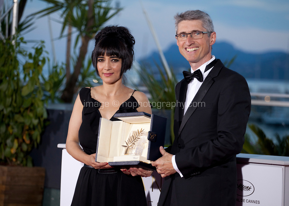 Producers Mitra Farahani and Fabrice Aragno after they received the Special Palme d'Or award on behalf of director Jean-Luc Godard at the Award Winner's photo call at the 71st Cannes Film Festival, Saturday 19th May 2018, Cannes, France. Photo credit: Doreen Kennedy