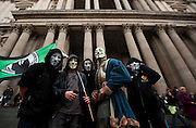 Protesters dressed in masks Occupy London protest outside St Pauls Cathedral in Central London on October 31st 2011..The Dean of St. Paul's Cathedral in London on Monday became the second high-profile clergy member to step down amid mounting controversy over anti-capitalist protests on the church's grounds.