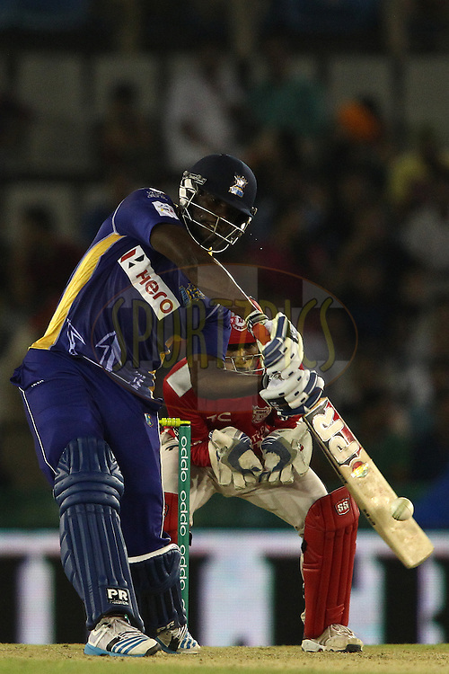 Raymon Reifer of the Barbados Tridents attacks a delivery during match 5 of the Oppo Champions League Twenty20 between the Kings XI Punjab and the Barbados Tridents held at the Punjab Cricket Association Stadium, Mohali, India on the 20th September 2014<br /> <br /> Photo by:  Shaun Roy / Sportzpics/ CLT20<br /> <br /> <br /> Image use is subject to the terms and conditions as laid out by the BCCI/ CLT20.  The terms and conditions can be downloaded here:<br /> <br /> http://sportzpics.photoshelter.com/gallery/CLT20-Image-Terms-and-Conditions-2014/G0000IfNJn535VPU/C0000QhhKadWcjYs