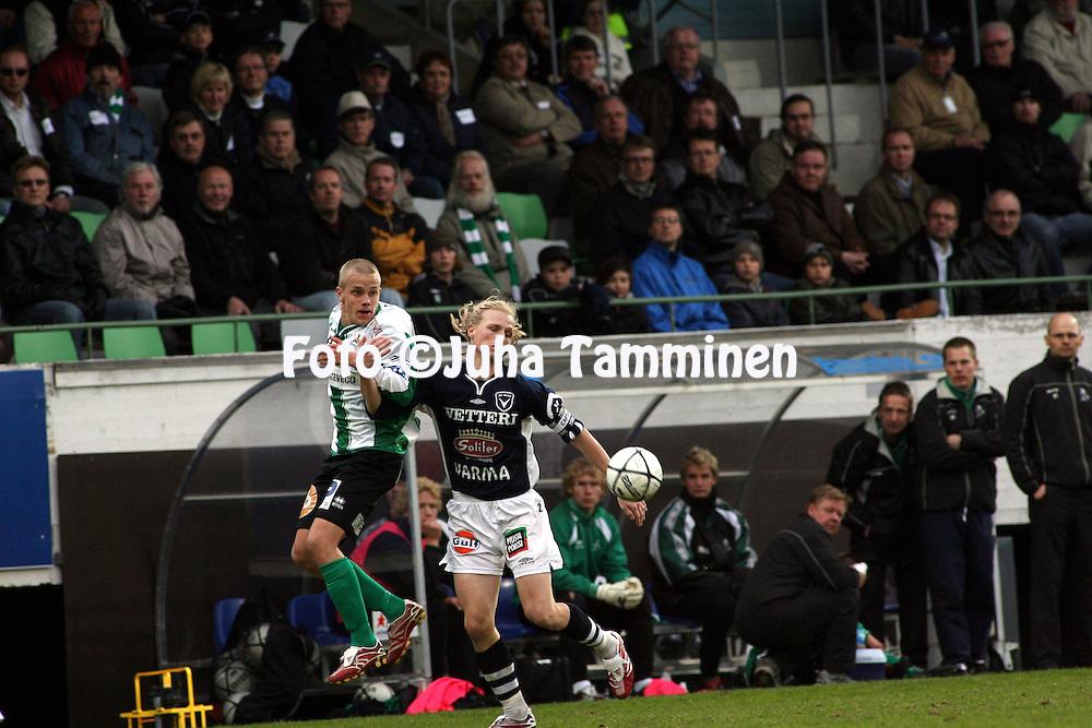 09.05.2007, Arto Tolsa Areena, Kotka, Finland..Veikkausliiga 2007 - Finnish League 2007.FC KooTeePee - AC Oulu.Janne Hietanen (AC Oulu) v Teemu Pukki (KooTeePee).©Juha Tamminen.....ARK:k