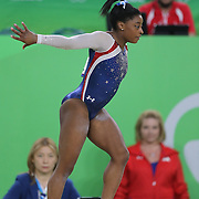 Gymnastics - Olympics: Day 6  Simone Biles #391 of the United States in action watched by her coach Aimee Boorman during her Floor Exercise during her gold Medal performance in the Artistic Gymnastics Women's Individual All-Around Final at the Rio Olympic Arena on August 11, 2016 in Rio de Janeiro, Brazil. (Photo by Tim Clayton/Corbis via Getty Images)