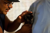 MCDERMITT, NV - AUG 16: Lyle Woods comforts his cat Teddie also known as Mr. D during a clinic sponsored by the Humane Society of the United States August 16, 2009 in McDermitt Nevada. (Photograph by David Paul Morris)