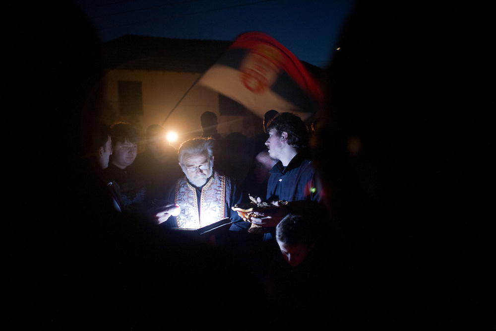 Father Milenko leads a prayer in the town center of Velika Hoca during Orthodox Christmas Eve celebrations...Orthodox Christmas (January 7) in the Serbian village of Velika Hoca, Kosovo.