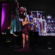 X-Factor, UK Star, Irina Dedyuk and pianist ,Dave Yaden performs at the Grand Final MISS USSR UK 2019 at Hilton hotel London on 27 April 2019, London, UK.