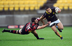 Wellington's Malo Tuitama, right, slips the tackle of Canterbury's Jack Straker in the Mitre 10 Rugby match at Westpac Stadium, Wellington, New Zealand, Sunday September 17,, 2017. Credit:SNPA / Ross Setford  **NO ARCHIVING**