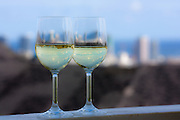 Two glasses of white wine against the city skyline