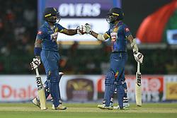 March 10, 2018 - Colombo, Sri Lanka - Sri Lankan cricketers Kusal Mendis and Kusal Perera congratulate each other during the 3rd T20 cricket match of NIDAHAS Trophy between Sri Lanka  and Bangladesh at R Premadasa cricket ground, Colombo, Sri Lanka on Saturday 10 March 2018. (Credit Image: © Tharaka Basnayaka/NurPhoto via ZUMA Press)
