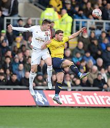 Franck Tabanou of Swansea City wins a high ball over Alex MacDonald of Oxford United  - Mandatory byline: Alex James/JMP - 10/01/2016 - FOOTBALL - Kassam Stadium - Oxford, England - Oxford United v Swansea City - FA Cup Third Round