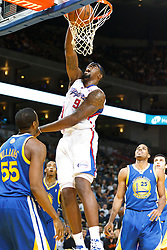 October 29, 2010; Oakland, CA, USA;  Los Angeles Clippers center DeAndre Jordan (9) dunks over Golden State Warriors small forward Reggie Williams (55) during the second quarter at Oracle Arena. The Warriors defeated the Clippers 109-91.