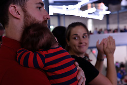 Mother Marion looks at seven-months-old Oliver, of Havertown, PA., on the shoulder of his father Dan Culter at a Family Town Hall event with Democratic presidential nominee Hillary Clinton, joined by daughter Chelsea Clinton, in Haverford, Pennsylvania, USA.